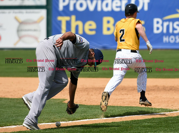 051617 Wesley Bunnell   Staff The New Britain Bees vs the Bridgeport Bluefish in the 2nd game of a double header played early afternoon on Tuesday. Jake McGuiggan (2) legs out an infield hit after the Bluefish pitcher is unable to make the play.