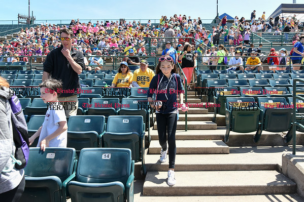 051617 Wesley Bunnell   Staff The New Britain Bees vs the Bridgeport Bluefish in the 2nd game of a double header played early afternoon on Tuesday. A young fan runs down with two baseballs to grab a photo from Nate Roe (13) who was sitting in the stands before the start of the game.