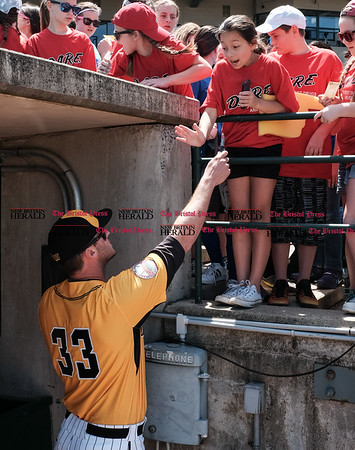 051617 Wesley Bunnell | Staff The New Britain Bees vs the Bridgeport Bluefish in the 2nd game of a double header played early afternoon on Tuesday. Jon Griffin (33) signs autographs before the start of the game and is asked for a high five.