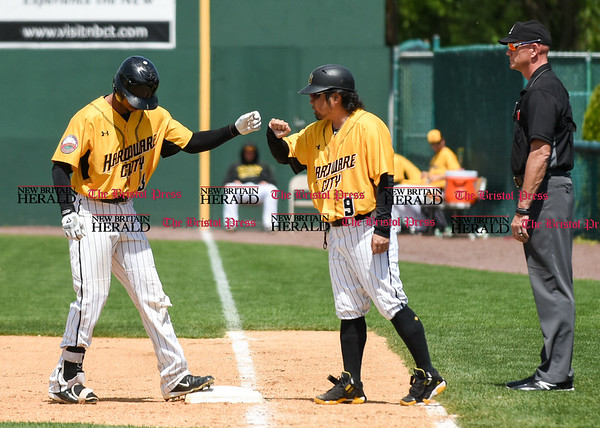 051617 Wesley Bunnell | Staff The New Britain Bees vs the Bridgeport Bluefish in the 2nd game of a double header played early afternoon on Tuesday. James Skelton (3) fist bumps first base coach Daisuke Yoshida (9).