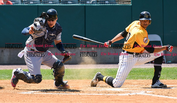 051617 Wesley Bunnell | Staff The New Britain Bees vs the Bridgeport Bluefish in the 2nd game of a double header played early afternoon on Tuesday. Bridgeport catcher Jose Gil (5) chases a dropped third strike but no throw was needed to first at the base was occupied.