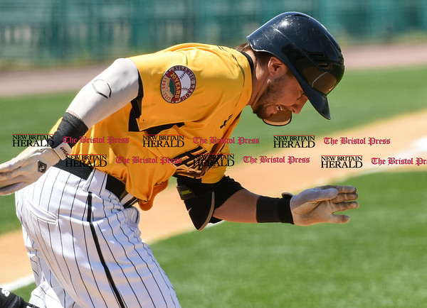 051617 Wesley Bunnell | Staff The New Britain Bees vs the Bridgeport Bluefish in the 2nd game of a double header played early afternoon on Tuesday. Michael Baca (5) puts his head down and digs down the first base line.