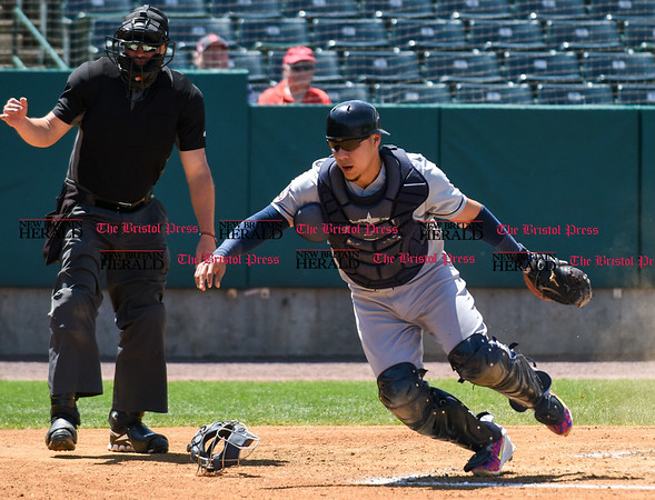 051617 Wesley Bunnell   Staff The New Britain Bees vs the Bridgeport Bluefish in the 2nd game of a double header played early afternoon on Tuesday. Bridgeport catcher Jose Gil (5) chases a dropped third strike but no throw was needed to first at the base was occupied.