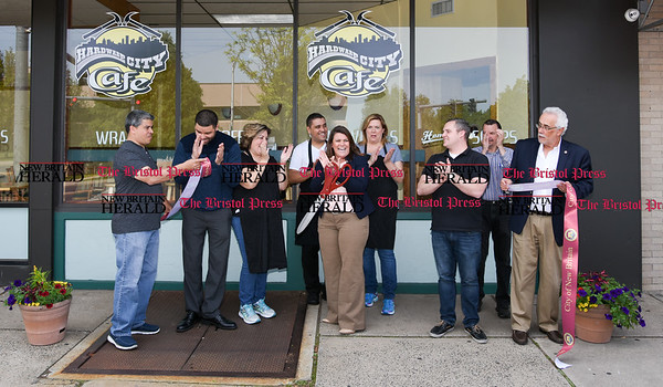 051617 Wesley Bunnell   Staff The Hardware City Cafe held its ribbon cutting on Tuesday afternoon with Mayor Erin Stewart and city officials. Alderman Carmelo Rodriguez Jr., L, Alderman Kristian Rosado, co-owner Miriam Geraci, co-owner Isaac Silva, Mayor Erin Stewart, co-owner Ellen Cedarfield, Alderman Robert Smedley & Alderman Daniel Salerno far right. Miriam Geraci, L, stands with Ellen Cedarfield along with Isaac Silva.