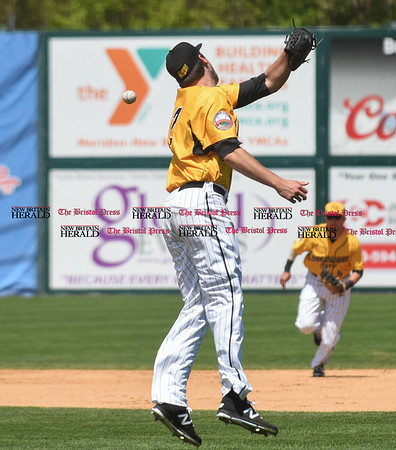 051617 Wesley Bunnell | Staff The New Britain Bees vs the Bridgeport Bluefish in the 2nd game of a double header played early afternoon on Tuesday. Jonathan Pettibone (32) jumps for a ball hit back up the middle but was fielded by Michael Baca (5).