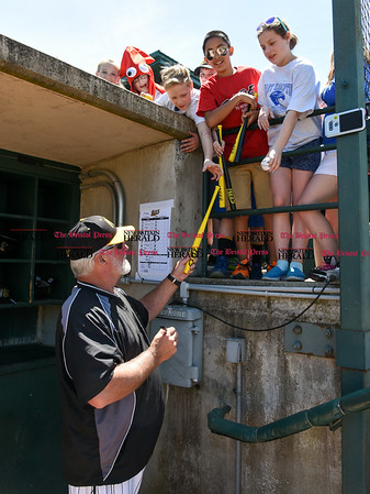 051617 Wesley Bunnell   Staff The New Britain Bees vs the Bridgeport Bluefish in the 2nd game of a double header played early afternoon on Tuesday. Manager Stan Cliburn (16) signs autographs for fans before the start of the game.