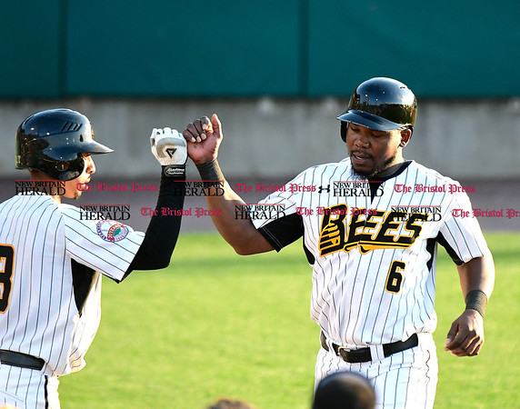 5/17/2017 Mike Orazzi | Staff New Britain Bees' James Skelton (3) and Jamar Walton (6) Wednesday night.