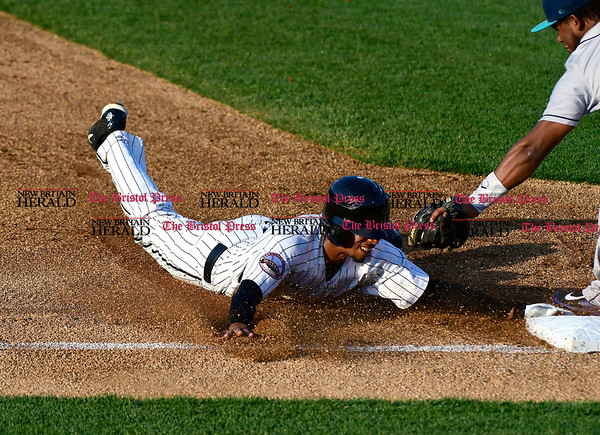 5/17/2017 Mike Orazzi | Staff New Britain Bees' James Skelton (3) slides safely into third Wednesday night.