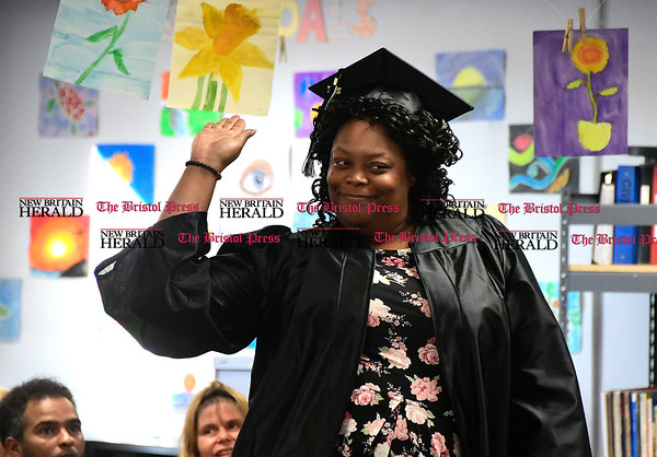 5/18/2017 Mike Orazzi | Staff Toyba Moore during Thursday night's Bristol Adult Education Graduation ceremony.