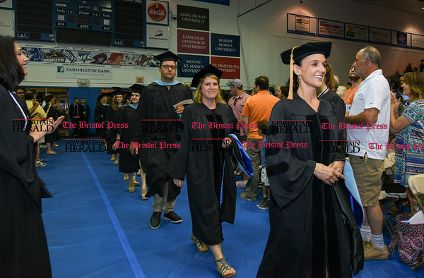 051817 Wesley Bunnell | Staff CCSU held commencement exercises on Thursday evening for graduate students at Kaiser Hall. Graduates file into the Hall at the start of the ceremony.