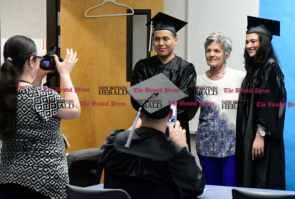 5/18/2017 Mike Orazzi | Staff Sandy Clauss with graduates Merill Curley and Rosa Martinez-Farias during Thursday night's Bristol Adult Education Graduation ceremony.