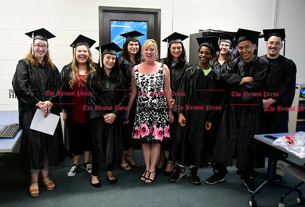5/18/2017 Mike Orazzi | Staff Sandy Clauss with some of the graduates before Thursday night's Bristol Adult Education Graduation ceremony.