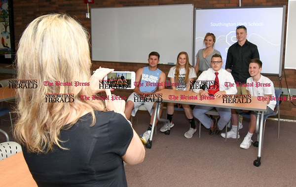 051917 Wesley Bunnell | Staff Southington High School wrestler Austin Abacherli's mother Sue takes a photo of Austin and friends after the signing of his letter of intent to wrestle for Sacred Heart University.