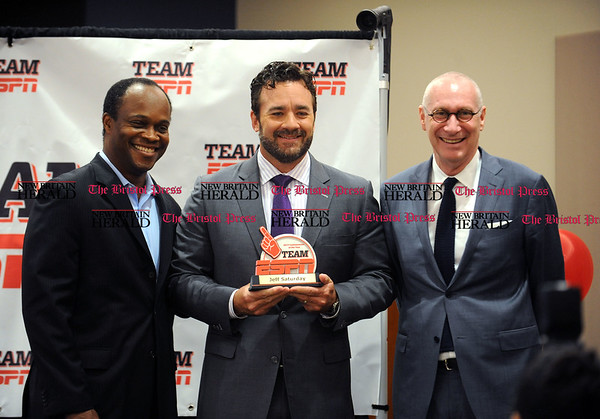 5/19/2017 Mike Orazzi | Staff ESPN commentator of the year Jeff Saturday with Rob King and ESPN President John Skipper during the volunteers of the year ceremony Friday in Bristol.