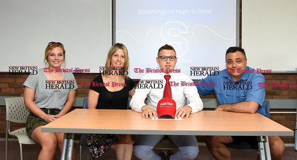 051917 Wesley Bunnell | Staff Southington High School wrestler Austin Abacherli after j just signing his letter of intent to wrestle for Sacred Heart University. He sits with his sister Allie, L, mother Sue and father Michael.