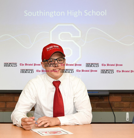 051917 Wesley Bunnell | Staff Southington High School wrestler Austin Abacherli signing his letter of intent to wrestle for Sacred Heart University.