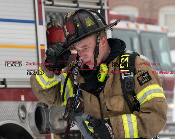 020917 Wesley Bunnell | Staff A multi family home at 116 West St. in New Britain was heavily damaged in a fire on Thursday Feb 9 with 10 people needed to be rescued from the burning building.