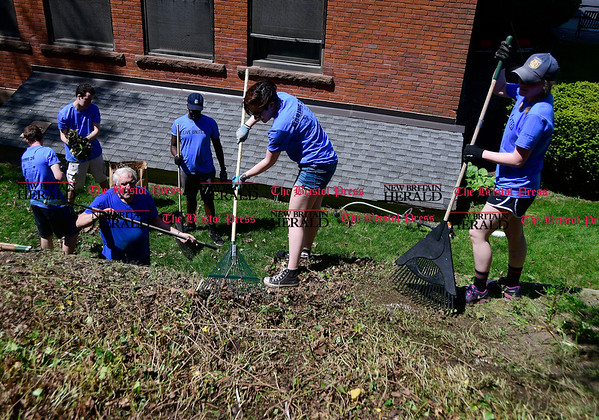 5/19/2017 Mike Orazzi | Staff Bristol Central High School volunteers Molly Watstein and Natalia Jesionka rake with fellow Untied Way Day of Caring volunteers while at the Bristol Historical Society Friday of the annual day of caring.