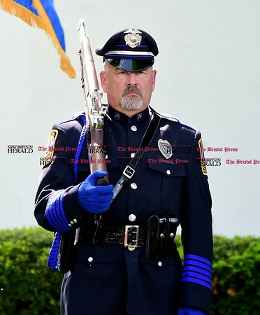 5/19/2017 Mike Orazzi | Staff Bristol Police Honor Guard member Peter Dauphinais at a ceremony to honor three Bristol officers who made the ultimate sacrifice on North Main Street Friday.