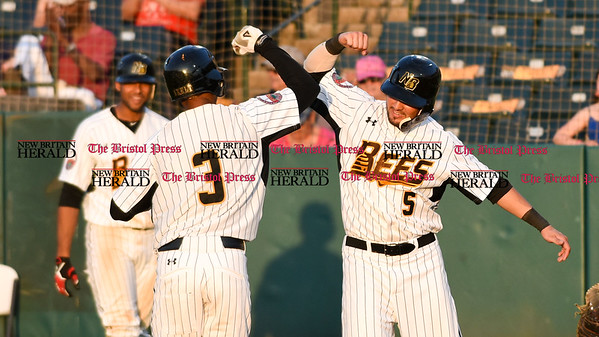 051817 Wesley Bunnell | Staff New Britain Bees vs the Bridgeport Bluefish on Thursday evening. James Skelton (3) is congratulated by Michael Baca (5) after the pair scored on a home run.