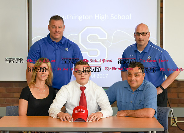 051917 Wesley Bunnell | Staff Southington High School wrestler Austin Abacherli after signing his letter of intent to wrestle for Sacred Heart University. Austin sits next to his mother Sue and father Michael. Back row is wrestling coach Derek Dion, L and athletic director Gregory Ferry.