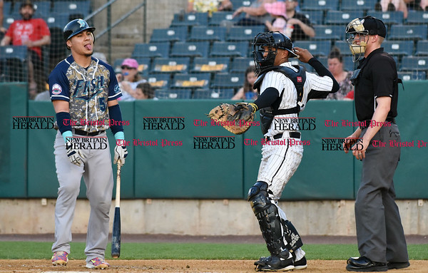 051817 Wesley Bunnell | Staff New Britain Bees vs the Bridgeport Bluefish on Thursday evening. Bridgeport Bluefish catcher Jose Gil (5) sticks his tongue out after striking out.