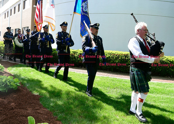 5/19/2017 Mike Orazzi | Staff Ian Rankine leads the Bristol Police Honor Guard at a ceremony to honor three Bristol officers who made the ultimate sacrifice on North Main Street Friday.