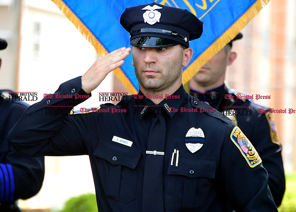 5/19/2017 Mike Orazzi | Staff Bristol Police Officer Vinny Infante at a ceremony to honor three Bristol officers who made the ultimate sacrifice on North Main Street Friday.