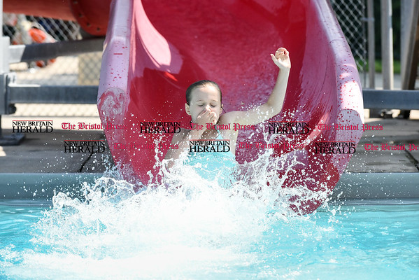 072116 Wesley Bunnell | Staff Brenna Cegiclski of Vernon plunges into the Willow Brook Park pool on Thursday afternoon.