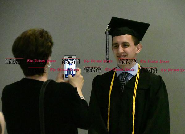 5/20/2017 Mike Orazzi   Staff Matt Caruso poses for a photograph at the the XL Center in Hartford for CCSU's graduation Saturday morning.
