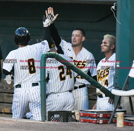 051817 Wesley Bunnell | Staff New Britain Bees vs the Bridgeport Bluefish on Thursday evening. Yusuke Kajimoto (8) gets high gives by Conor Bierfeldt (28) as Steve Carillo (4) looks on.