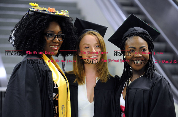 5/20/2017 Mike Orazzi   Staff Ivie Efianayi, Casey Simoncelli and Yawavi Kafui Simpini while at CCSU's graduation Saturday morning at the XL Center in Hartford.