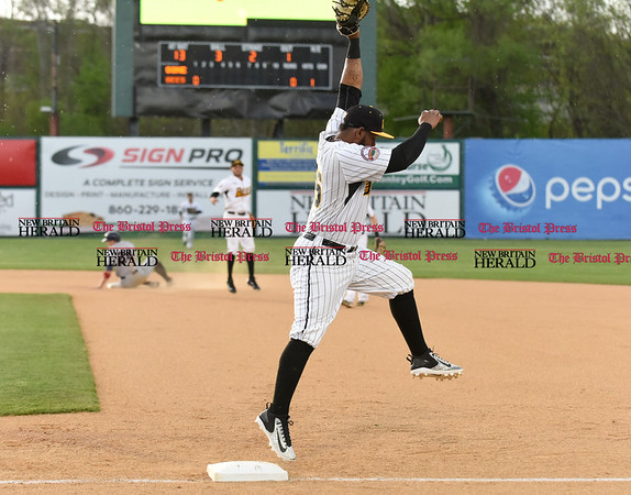 050217 Wesley Bunnell   Staff The New Britain Bees vs Somerset Patriots on Tuesday evening. Jovan Rosa (35) is pulled off the bag on the second half of a attempted double play.