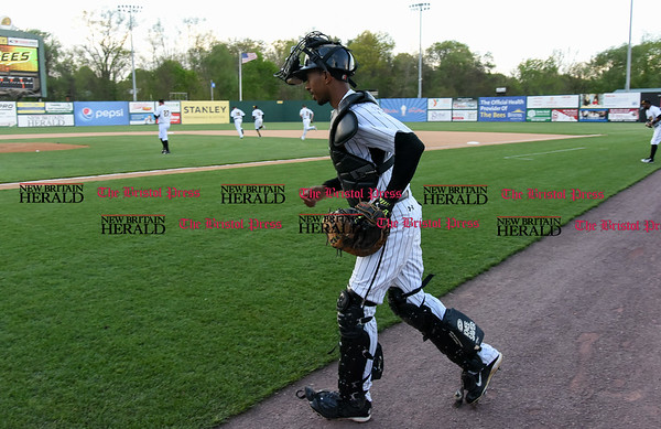 050217 Wesley Bunnell | Staff The New Britain Bees vs Somerset Patriots on Tuesday evening. James Skelton (3) jogs onto the field just before the National Anthem.