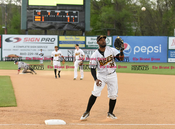 050217 Wesley Bunnell | Staff The New Britain Bees vs Somerset Patriots on Tuesday evening. Jovan Rosa (35) is pulled off the bag on the second half of a attempted double play.
