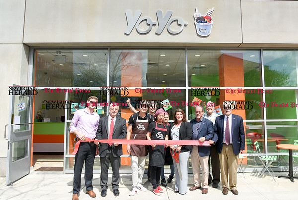050217 Wesley Bunnell | Staff Yo Yo Ice Cream held their ribbon cutting ceremony with Mayor Erin Stewart and city officials. Broker Eric Amodio, Economic Development Director Bill Carroll, co-owner JianJiim Chen, co-owner Takay Chen, co-owner Jessie Ouyang, Carmen Huertas, Mayor Erin Stewart, New Britain Chamber of Commer President Tim Stewart, Alderman Dom Naples and Alderman Daniel Salerno.