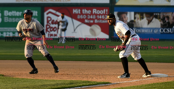 050217 Wesley Bunnell   Staff The New Britain Bees vs Somerset Patriots on Tuesday evening. Jovan Rosa (35) holds the Somerset runner on.