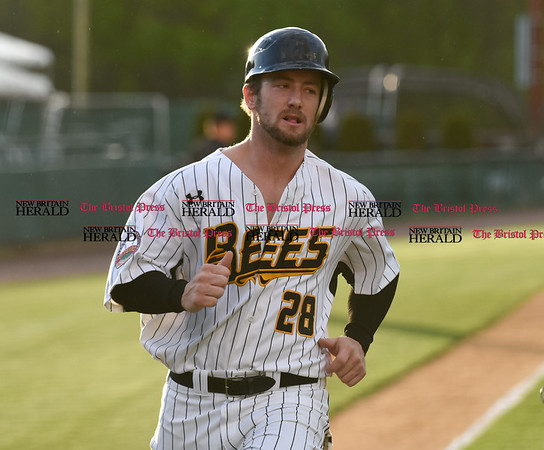 050217 Wesley Bunnell | Staff The New Britain Bees vs Somerset Patriots on Tuesday evening. Conor Bierfeldt (28) comes home to score.