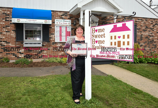 050217 Wesley Bunnell   Staff Owner Elaine Pavasaris of Home Sweet Home Realty holds her award for best real estate in the town of Berlin.