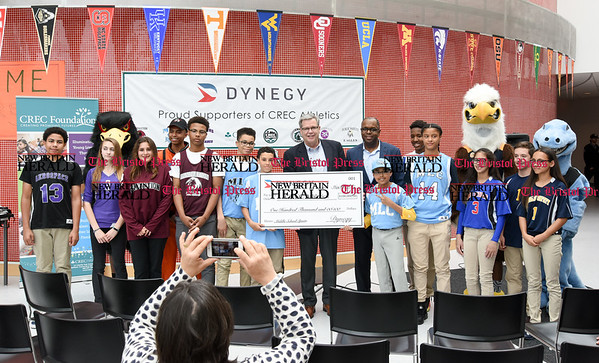 052217 Wesley Bunnell | Staff Energy company Dynegy visited CREC Academy of Science & Innovation to present a donation for $100,000 for CREC athletics. Executive V.P. of Operations Marty Daley, middle and Executive V.P. & Chief Administration Officer Julius Cox present a ceremonial check surrounded by student athletes from all schools.