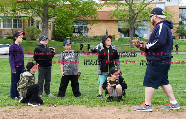 050417 Wesley Bunnell | Staff Coach Chris Waszkiewicz leads the Big Red team of the New Britain Little League team in practice in Walnut Hill Park on Thursday afternoon. Jacqueline Pena, left, Jeremiah Pena, Geno Plourde, Andy Rivera, Eli Radin & Roy Waszkiewicz.