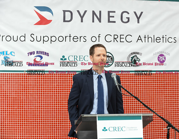 052217 Wesley Bunnell | Staff Energy company Dynegy visited CREC Academy of Science & Innovation to present a donation for $100,000 for CREC athletics. CREC Athletic Director John Winer.