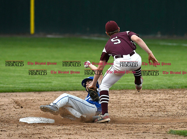 5/23/2017 Mike Orazzi | Staff Bristol Central's Noah Plantamuro (5) as Bristol Eastern's Cory Fradette (8) slides safely into second Tuesday night at Muzzy Field.