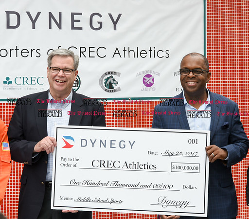 052217 Wesley Bunnell | Staff Energy company Dynegy visited CREC Academy of Science & Innovation to present a donation for $100,000 for CREC athletics. Executive V.P. of Operations Marty Daley, middle and Executive V.P. & Chief Administration Officer Julius Cox.