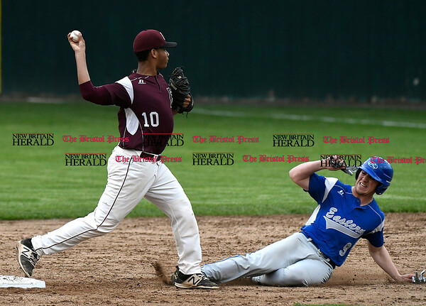 5/23/2017 Mike Orazzi | Staff Bristol Central's Jaylen Dias (10) forces out Bristol Eastern's Zach Marquis (9) at second Tuesday night at Muzzy Field.