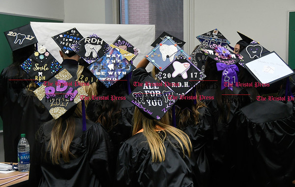 5/25/2017 Mike Orazzi | Staff Tunxis Community College graduates show off their caps at the Forty-sixth Commencement Thursday evening in Farmington.