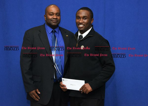 052517 Wesley Bunnell | Staff The New Britain High School Senior Scholarship night was held on Thursday evening at the school. Kevin Harris received the Boys and Girls Club of New Britain John Karbonic Scholarship from Mr. Jason Gibson to study Criminal Justice and Homeland Security at Dean College.