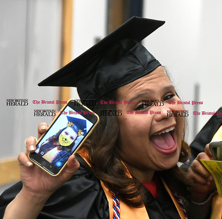 5/25/2017 Mike Orazzi | Staff Tunxis Community College graduates Sharri Mendez shows off her selfie at the Forty-sixth Commencement Thursday evening in Farmington.