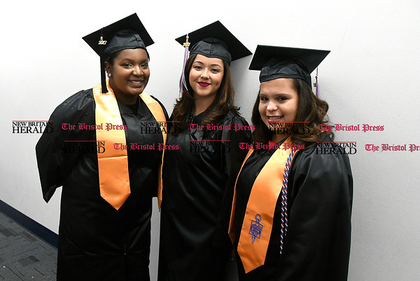 5/25/2017 Mike Orazzi | Staff Tunxis Community College graduates Tiara James, Neshlie Gonzalez and Sharri Mendez at the Forty-sixth Commencement Thursday evening in Farmington.