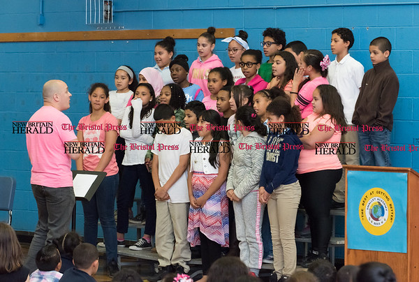 052617 Wesley Bunnell | Staff Smalley Academy presented the CT Breast Health Initiative with a check for over $2,000 through various fund raising activities. The Smalley Elementary Chorus sings Lean on Me.